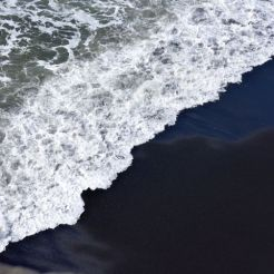 Black sand and wave at Dyrholaey